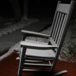 Chair dusted with snow