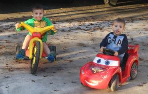 Boys on riding toys